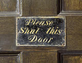 "Detail of the door plate to the Old Kitchen at Belton House inscribed ""Please Shut this Door"""