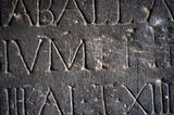 Close detail of an inscribed Roman slab at Petworth House