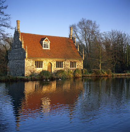 The quaint Bourne Mill, seen across the mill pond