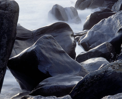 A detailed close up of sodden rocks on the coastline of Murlough Bay, Northern Island