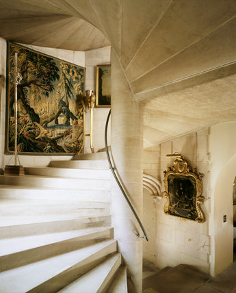 The Spiral Stairs looking up from the Long Gallery, showing the French C18th Chinoiserie tapestry and the C18th giltwood torcheres