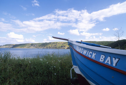 A boat at Runswick Bay, with the name 'Runswick Bay' on the side of it