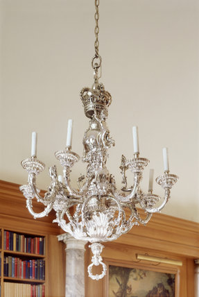One of a pair of silver chandeliers in the Library