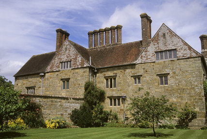Exterior view of the back of Bateman's house in Kent