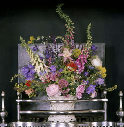 18th century flower arrangement in the fireplace in Mrs Child's Dressing Room at Osterley