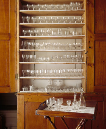 Glassware in the cupboard in the Servery at Blickling Hall