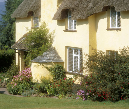 Front of a thatched cottage at Selworthy Village, Somerset