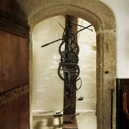 View of the pre-pendulum clock made of wrought iron and mounted on a stout vertical oak beam
