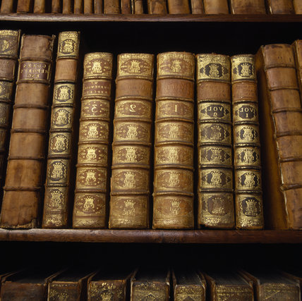 Leather bound books in the library at Dunham Massey
