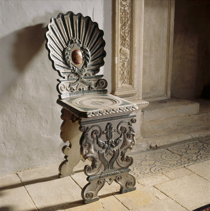 Close-up of one of a set of six early 17th century `sgabello' hall chairs, probably by Franz Cleyn, in the Stone Gallery at Lacock Abbey