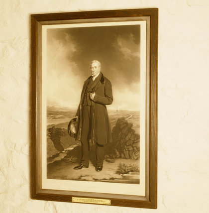 A portrait of George Stephenson on the wall at the cottage where he was born in 1781