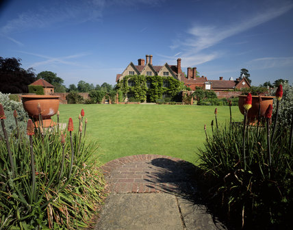 South side of Packwood House, looking across the lawn through the herbaceous border