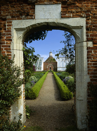 A Walled Garden with box-edged paths and conservatories