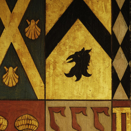 Close view of part of the Wade family coat of arms in the Entrance Hall at Snowshill Manor, Gloucestershire