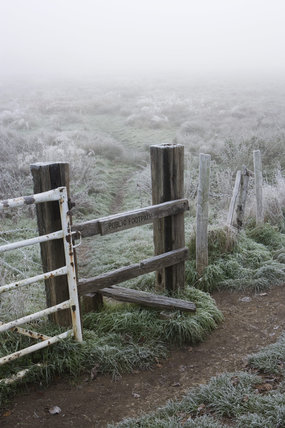A stile on the banks of the River Wey Navigations near Triggs Lock, Send, Surrey on a misty and frosty November day