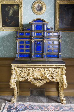 A late seventeenth century Italian, Florentine, lapis lazuli cabinet on a Charles II giltwood stand in the Dressing Room at Belton House, Lincolnshire, UK