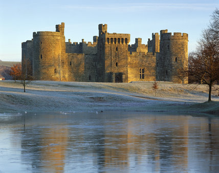 Bodiam Castle, taken in the winter with heavy frost on the ground and flooding in the foreground