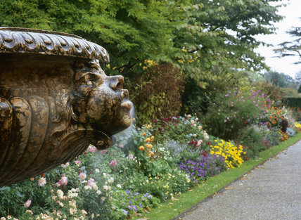 One of the heads on the fountain in the Wall Garden at Nymans, it is carved in Verona red marble