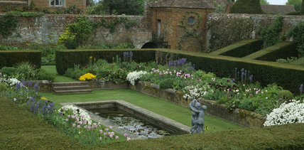The Sunken Garden at Packwood House was constructed in its present form by Baron Ash the colourful flower beds surrounding the oblong pond are enclosed by a clean cut box hedge