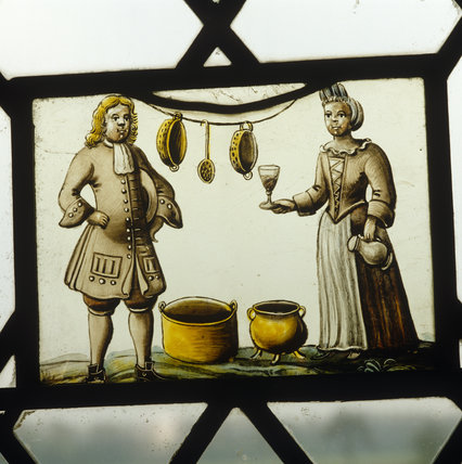 Oxburgh Hall, the Kings room, continental painted glass from the windows (16th & 17th century) of a domestic scene, a couple with kitchen utensils