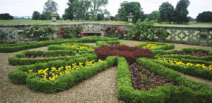 The parterre at Charlecote Park with a decorative stone wall surrounding it