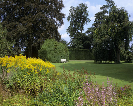 An herbaceous border beside an immaculate lawn at Melford Hall
