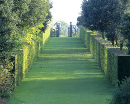 A view down the Long Walk at Hidcote Manor Garden towards the gate - open to lead the eye towards the landscape