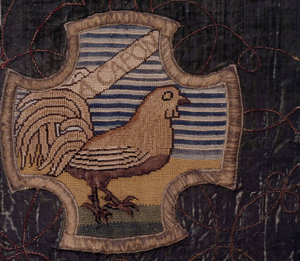 A motif of a capon from the Marian Needlework at Oxburgh Hall