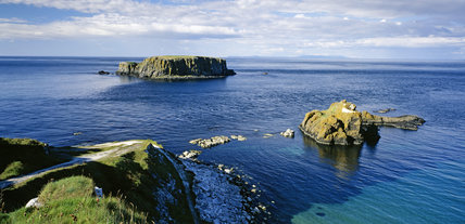 The coastline near Carrick-a-Rede in northern Ireland, showing two rocky islands