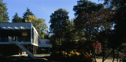 The Homewood, built in 1938 by Patrick Gwynne, here looking at the Dining Room and terrace end, with the bedroom wing visible in the further distance and surrounded by landscaped garden and trees