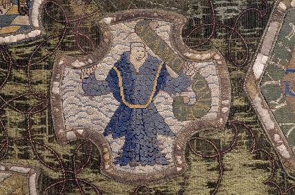 A sea creature in the form of a merman from the Marian Needlework at Oxburgh Hall