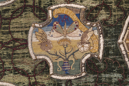 A motif of butterflies and flowers, and the initials MR from the Marian Needlework at Oxburgh Hall