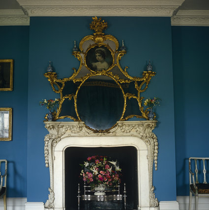 The wooden chimneypiece and overmantel made by John Linnell for Mrs. Child's Dressing Room at Osterley Park with marble inset and portrait said to be of Sarah Anne Child born in 1764.