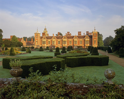 The East front of Blickling Hall, one of England's great Jacobean houses built in the early C17th, with the Parterre Garden in the foreground