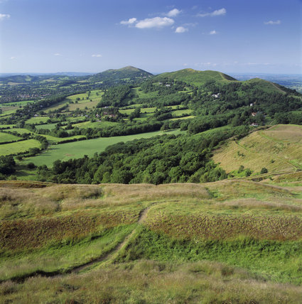 View of the northern end of the Malvern Hills taken from the British camp showing the Worcestershire Beacon with woods and hedged fields below