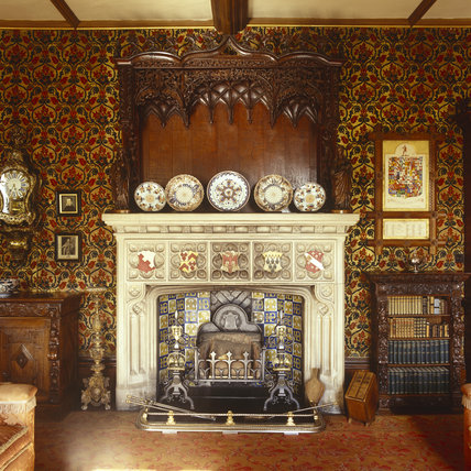 View of the neo-Tudor fireplace in the Library at Oxburgh Hall