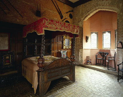 View of the bed and linenfold panelling in The King's Room at Oxburgh Hall