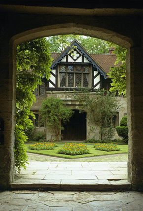 A view through a doorway at Baddesley Clinton, across the courtyard to a gabled entrance beyond