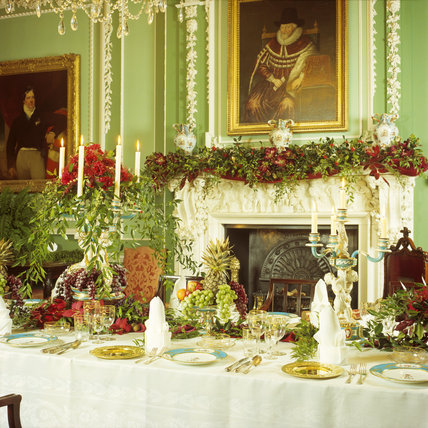 View of elaborately decorated dining table in the Dining Hall at Tatton Park for a Christmas celebration