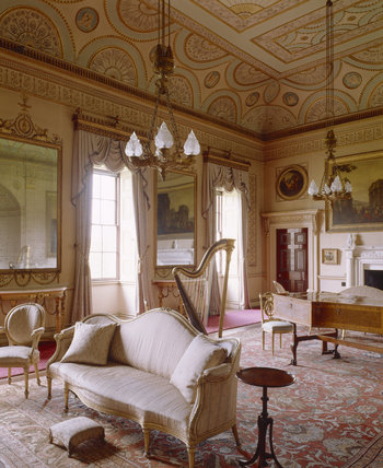 View of the Saloon at Nostell Priory showing the Robert Adam ceiling painted in 1773, two pier glasses and harpsichord by Jacob Kirckman of 1766 in a case inlaid with Rococo ornament