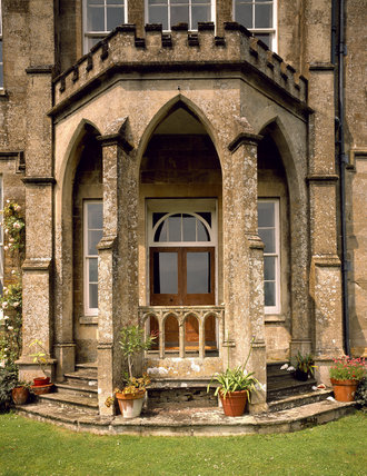 This shows in detail the Gothic porch and doorway on the South Front of Newark Park, Glos