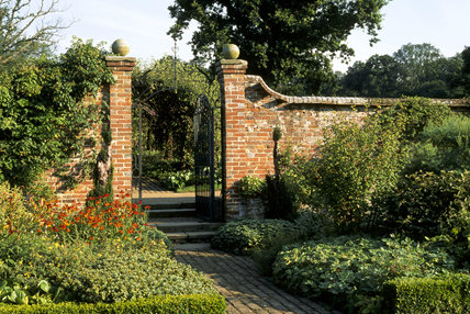 View of the gate between the Mulberry Garden and Pear Walk at Bateman's in East Sussex