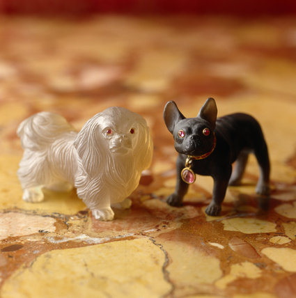 A close-up of two miniature Faberge dogs from the Drawing Room at Polesden Lacey