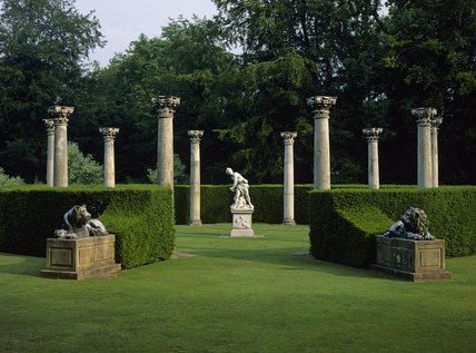 The Temple Lawn in Anglesey Abbey Gardens, with its ten Corinthian columns of Portland stone, surrounding a replica of Bernini's David executed by G