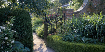 View of the gateway to the main border in the garden at Beningbrough Hall