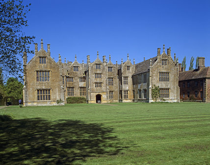 View across a sunlit lawn towards Barrington Court, Somerset