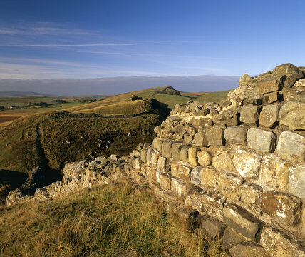 Hadrian's Wall snaking away into the distance, with the near part in a state of disrepair