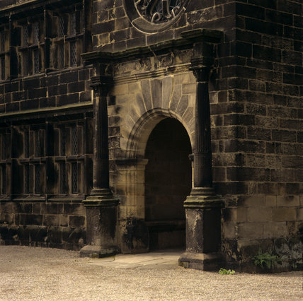 Close-up of the entrance porch, showing the imposing pillars