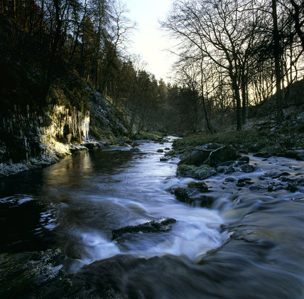A view of ice formations beside Hebden Water in the Winter