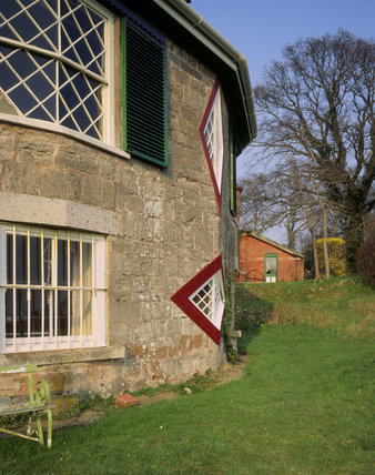 Exterior of A La Ronde, a curious 16 sided house with diamond shaped windows, built for the Misses Parminter about 1795 on their return from a European tour